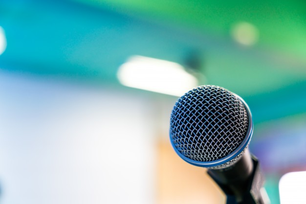 black-microphone-in-conference-room-filtered-image-processed-v 1232-3311